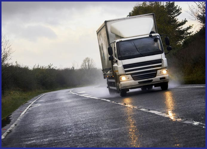 Lorry on wet road